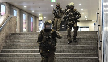 Police officers patrol inside a subway station near the Munich shopping mall where a shooting took place, July 22, 2016.