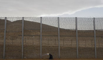 Sudanese migrant worker Mohammed Yusef working on the construction of a barrier on the border between Israel and Egypt along Israel's Highway 12, a desert road north of the Red Sea resort of Eilat, in this February 15, 2012 file photo.