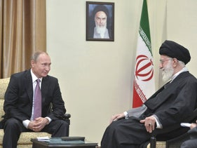 Russia's President Putin, left, who arrived to attend the Gas Exporting Countries Forum, meets with Iran's Supreme Leader Khamenei in Tehran, Iran, November 23, 2015.