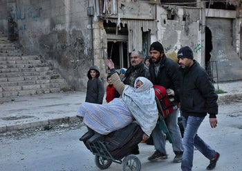 Residents fleeing the violence in the rebel-held parts of Aleppo evacuate through the Bab al-Hadid district, Aleppo, Syria December 7, 2016.