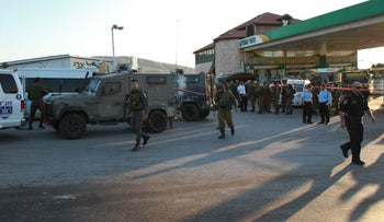 The scene of a stabbing attack at a West Bank gas station on Route 443, November 23, 2015.
