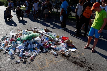 A boy looks at a pile of garbage placed where police shot dead Mohamed Salmene Lahouaiej-Bouhlel on July 14, 2016.
