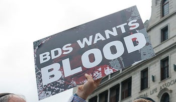 FILE PHOTO: Member of Jewish Representative Council stage a protest against Boycott, Divestment and Sanctions Movement (BDS) in front of the Sir Herbert Baker building in Cape Town, South Africa on February 13, 2015.