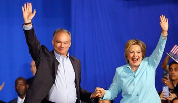 Democratic presidential candidate Hillary Clinton and her running mate Senator Tim Kaine wave to supporters during a campaign rally in Miami, Florida, U.S. July 23, 2016.