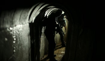 Palestinian fighters from the Izz el-Deen al-Qassam Brigades, the armed wing of the Hamas movement, are seen inside an underground tunnel in Gaza August 18, 2014.