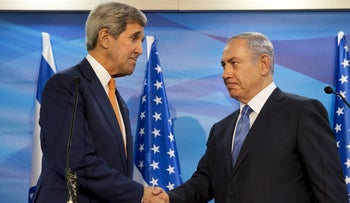 U.S. Secretary of State John Kerry, left, shakes hands with Prime Minister Benjamin Netanyahu before their meeting at the Prime Minister's Office in Jerusalem, November 24, 2015.