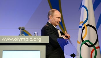 In this Feb. 6, 2014 photo Russian President Vladimir Putin leaves the stage after speaking at the IOC President's Gala Dinner on the eve of the opening ceremony of the Winter Olympics in Sochi, Russia.