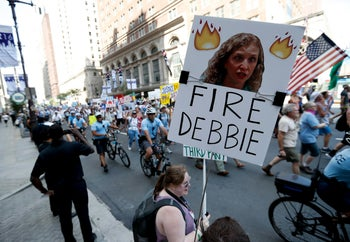 A supporters of Sen. Bernie Sanders holds up a sign call calling for Debbie Wasserman Schultz, chairwoman of the Democratic National Committee to be fired, July 24, 2016, in Philadelphia.