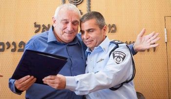 Police commander Shlomi Michael with former Public Security Minister Yitzhak Aharonovitch