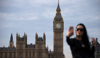 A woman takes a selfie photograph in front of the Elizabeth Tower, otherwise known as Big Ben, at the Houses of Parliament in central London on December 7, 2016.