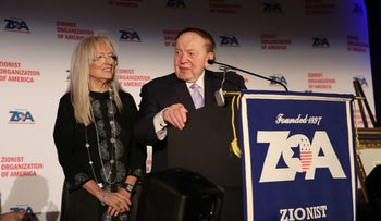 Dr. Miriam Adelson, left, and Sheldon Adelson at the rostrum during the awards dinner.