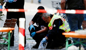 Police secure the area after the explosion in Ansbach, Germany, July 25, 2016.