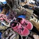 Donated shoes lie at a sorting space before their distribution to an expected influx of Syrian refugees, in Toronto November 24, 2015.