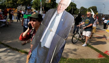 A protester carries a cutout of Bernie Sanders during a march against presumptive Democratic presidential nominee Hillary Clinton, ahead of the Democratic National Convention, in Philadelphia, July 24, 2016.