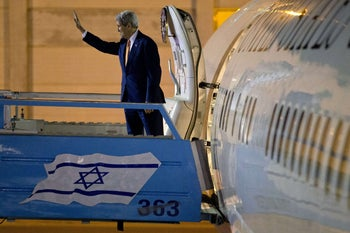 US Secretary of State John Kerry waves as he boards his plane in Tel Aviv prior to his departure from Israel en route back to the United States following meetings in Jerusalem and the West Bank city of Ramallah on November 24, 2015.