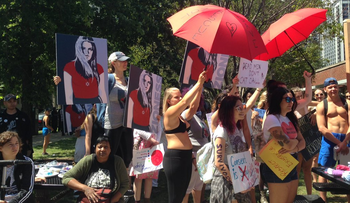 Activists try to block pro-Israel protesters' banners at SlutWalk Chicago, August 12, 2017.