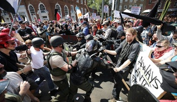 White nationalists, neo-Nazis and members of the 'alt-right' clash with counter-protesters as they enter Lee Park during the 'Unite the Right' rally August 12, 2017 in Charlottesville, Virginia.