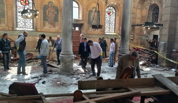 Egyptian security forces examine the scene inside St. Mark Cathedral in central Cairo, following a bombing, Sunday, Dec. 11, 2016. The blast at Egypt's main Coptic Christian cathedral killed dozens of people and wounded many others on Sunday, according to Egyptian state television, making it one of the deadliest attacks carried out against the religious minority in recent memory. (Omar El-Hady via AP)