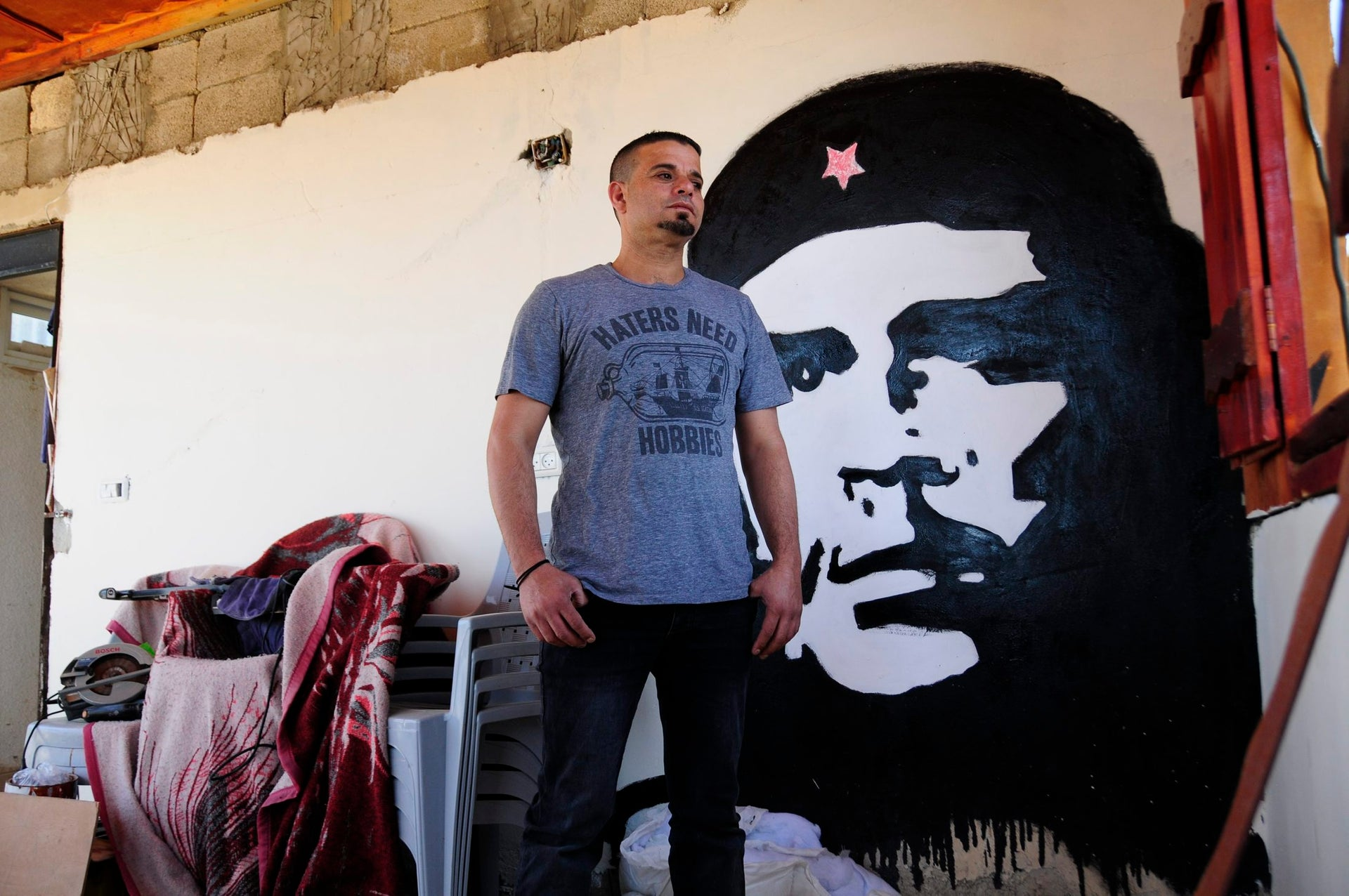 Political activist and skateboarding advocate Mohammed Othman standing in his home.