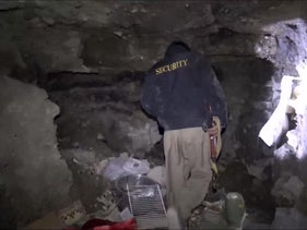 A still from a video of Kurdish security forces in a tunnel complex under the city of Sinjar that were used by Islamic State militants, November 22, 2015.