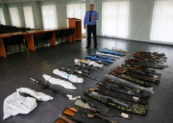 Slaviansk's chief of police Serhiy Alyoshin watches over confiscated weapons at a police station in Slaviansk in Donetsk region, Ukraine, June 30, 2016. Picture taken June 30, 2016.
