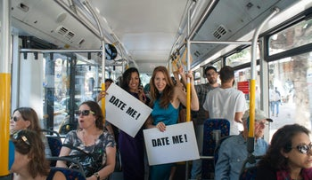 Yifat Sharabi, left, and Ayala Shiftan looking for someone to date, on a Tel Aviv bus.