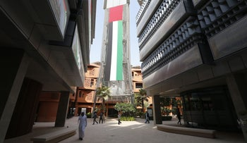 People walk in Masdar City in Abu Dhabi, which hosts the International Renewable Energy Association Agency (IRENA), October 7, 2015.