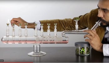 A screenshot from a video demonstrating the use of the menorah bong.