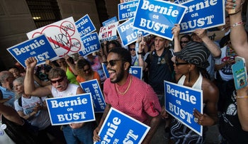 Supporters of former U.S. Democratic presidential candidate Bernie Sanders hold signs at a rally at City Hall in Philadelphia, U.S., July 25, 2016.
