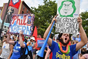 Bernie Sanders supporters march through downtown Philadelphia on the first day of the Democratic National Convention on July 25, 2016.