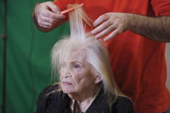 Sarah Israel, 85, a Holocaust survivor, has her hair done during preparations ahead of a beauty contest for survivors of the Nazi genocide in the northern Israeli city of Haifa. November 24, 2015.