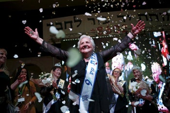 Rita Berkowitz, 83, a Holocaust survivor and winner of a beauty contest for survivors of the Nazi genocide, waves on a stage, in the northern Israeli city of Haifa. November 24, 2015.