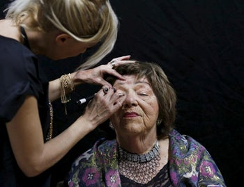 Stela Krashes, 85, a Holocaust survivor, has her make-up done during preparations ahead of a beauty contest for survivors of the Nazi genocide in the northern Israeli city of Haifa. November 24, 2015.