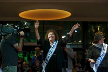 Linda Ruben, 82, a Holocaust survivor, walks on a runway during a beauty contest for survivors of the Nazi genocide in the northern Israeli city of Haifa, November 24, 2015.