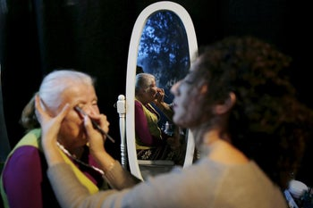Sarah Israel, 85, a Holocaust survivor, has her make-up done during preparations ahead of a beauty contest for survivors of the Nazi genocide in the northern Israeli city of Haifa. November 24, 2015.