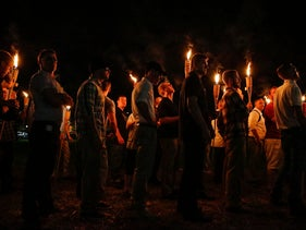 Torch-wielding white nationalists march on the University of Virginia in Charlottesville, August 11, 2017.