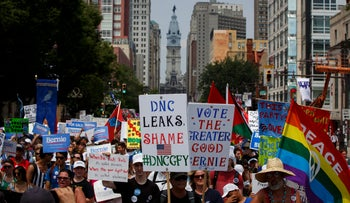 People march protesting the DNC email Wikileaks scandal and holding signs in support of former Democratic presidential candidate Bernie Sanders during a protest at the 2016 Democratic National Convention, July 25, 2016.