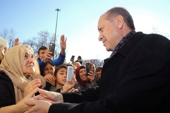 Turkey's President Erdogan with supporters after the bombings in Istanbul, December, 11, 2016.