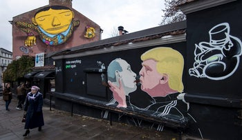 Graffiti depicting Russian President Vladimir Putin, left, and Republican presidential candidate Donald Trump, on the walls of a bar in the old town in Vilnius, Lithuania, Sunday, Oct. 30, 2016.