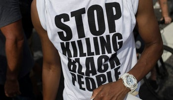 A protester wears a shirt reading 'Stop Killing Black People' while demonstrating at a Black Lives Matter rally during the Democratic National Convention in Philadelphia on July 26, 2016.