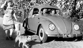 A 1950s publicity photograph from Volkswagen's historical archives shows a VW Beetle in rural Germany. Victor Elmaleh, a Moroccan-born Jew, would bring the Beetle to the States shortly after WWII ended.