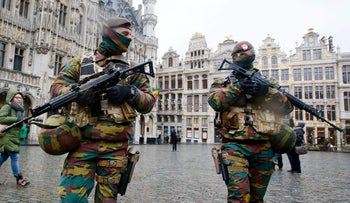 Belgium police officers patrol the Grand Place in central Brussels, November 24, 2015.