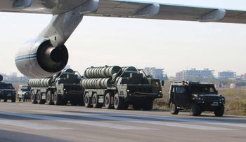 Russia's S-400 air-defense missile systems are carried aboard trucks at the Hmeimim airbase in Syria on November 26.