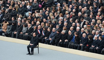 French President Francois Hollande and other members of the government attend a ceremony in honour of the 130 people killed in the Paris attacks, November 27, 2015.