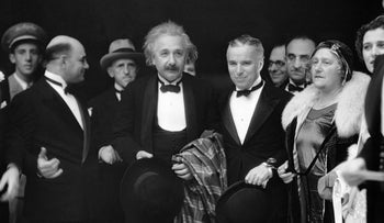 "Albert Einstein and Charlie Chaplin (center) line up at the premiere of the latter's ""City Lights"" movie in 1931."
