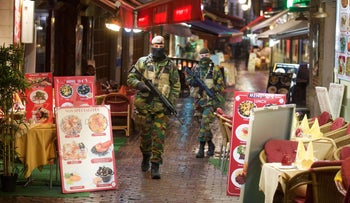 Soldiers patrol in the Rue des Bouchers in Brussels, November 24, 2015.