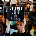 """A woman holds up a sign proclaiming """"I am a French Jew' at a support rally in Jerusalem following the murders in Paris last January."""