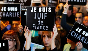 "A woman holds up a sign proclaiming ""I am a French Jew' at a support rally in Jerusalem following the murders in Paris last January."