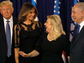 Sara Netanyahu, second from right, and Melania Trump walking with their husbands, U.S. President Donald Trump and Israeli Prime Minister Benjamin Netanyahu, before a dinner at the Prime Minister's Residence in Jerusalem, May 22, 2017.