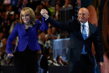 Former Rep. Gabby Giffords, D-Ariz, addresses delegates alongside her husband Astronaut Mark Kelly (Ret.), during the third day of the Democratic National Convention in Philadelphia , Wednesday, July 27, 2016. (AP Photo/Mark J. Terrill)